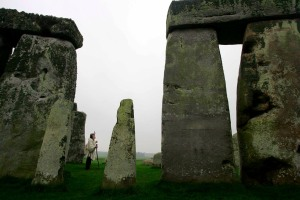 photograph showing Arch Druid Keeper of the Stones Terry Dobney inspecting the famous British landmark Stonehenge in Wiltshire, south west England.