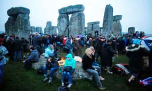 Crowds at Stonehenge at dawn for the summer solstice. Photograph: Barry Batchelor/PA