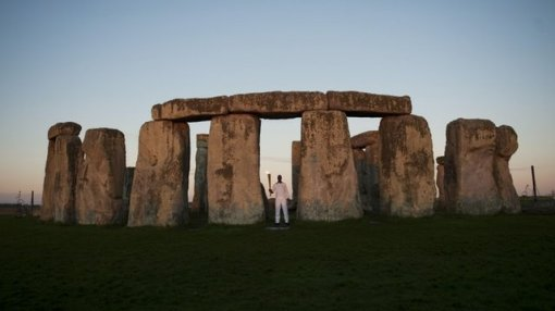 Michael Johnson carried the torch around Stonehenge