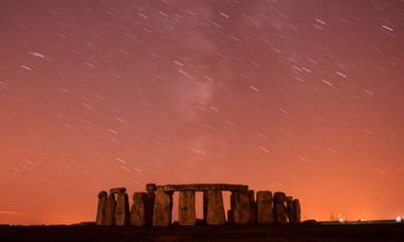 The Perseid meteor shower streaks past Stonehenge in Salisbury Plain. Photograph: Kieran Doherty / Reuters