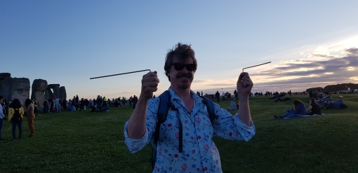 Dowsing the Stones at the Summer Solstice Celebrations. There is evidence that these straight tracks were used by the ancient peoples for spiritual purposes, and also for purposes such as trading and commerce. Photo of a tour guide demonstrating the ancient art divining.